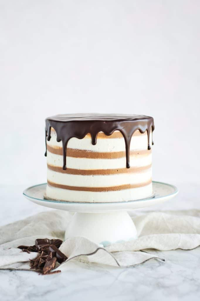 Zebra Marble Layer Cake | Classic combination of chocolate and vanilla flavours with a  zebra pattern twist! Soft and moist cake, filled with rich chocolate ganache and silky vanilla ermine buttercream. | www.anasbakingchronicles.com