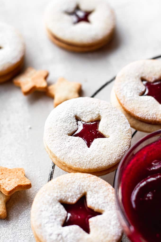 Traditionally made for Christmas and other holidays, these Linzer cookies are soft but crumbly, sandwiched together with homemade raspberry jam.⎪www.anasbakingchronicles.com