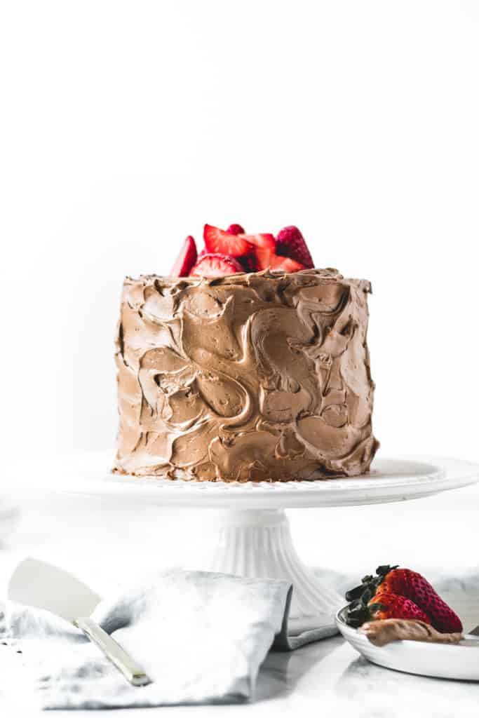 Three layers of rich and soft chocolate cake, paired with light and airy chocolate buttercream and filled with luscious dark chocolate ganache.  It doesn't get more chocolatey than this!⎪www.anasbakingchronicles.com