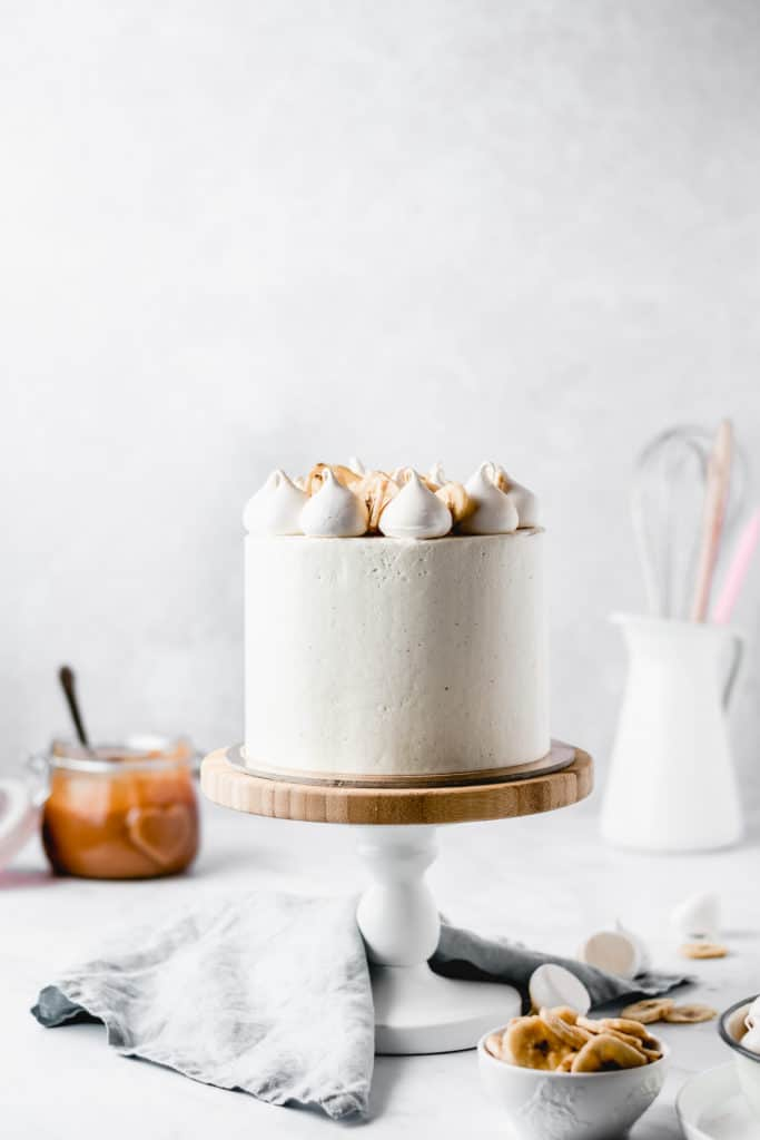 This Dulce de leche Banana Cake is a dream come true! Rich and moist banana cake layers are filled with luscious dulce de leche and coated in the most beautiful vanilla bean frosting! Perfect for Mother's Day! ⎪www.anasbakingchronicles.com