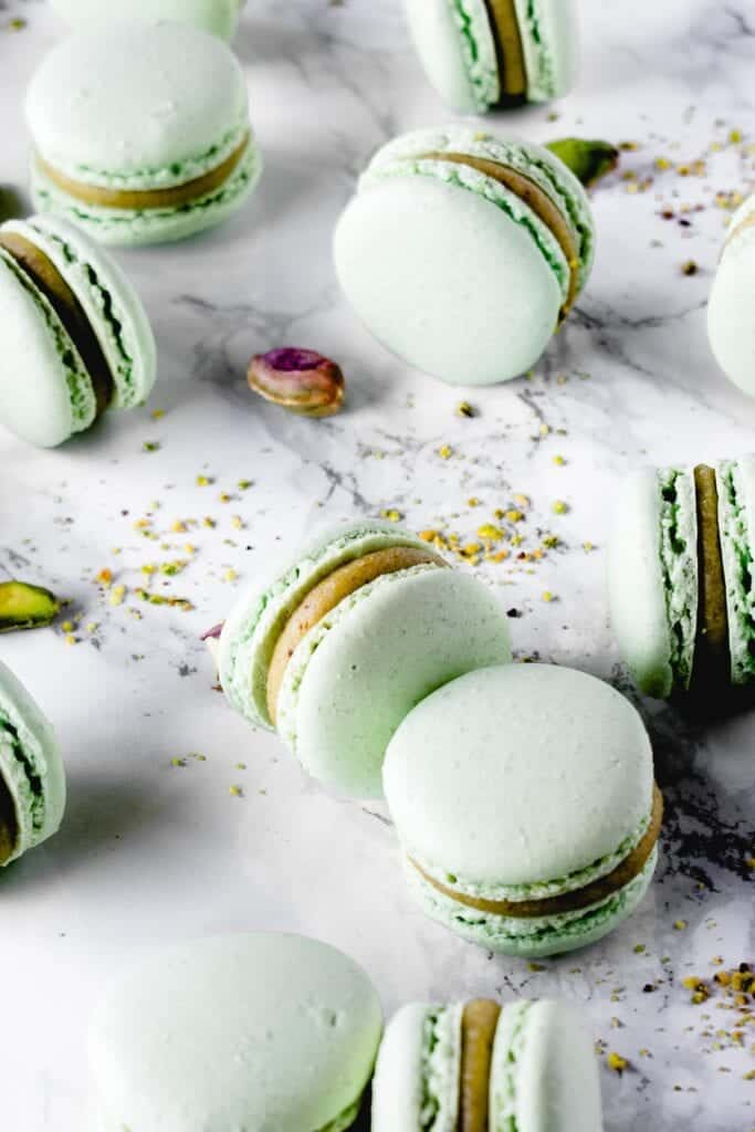 Sweet and chewy macarons, the most decadent of French desserts, filled with rich Pistachio White Chocolate ganache. It's a match made in heaven!⎪www.anasbakingchronicles.com