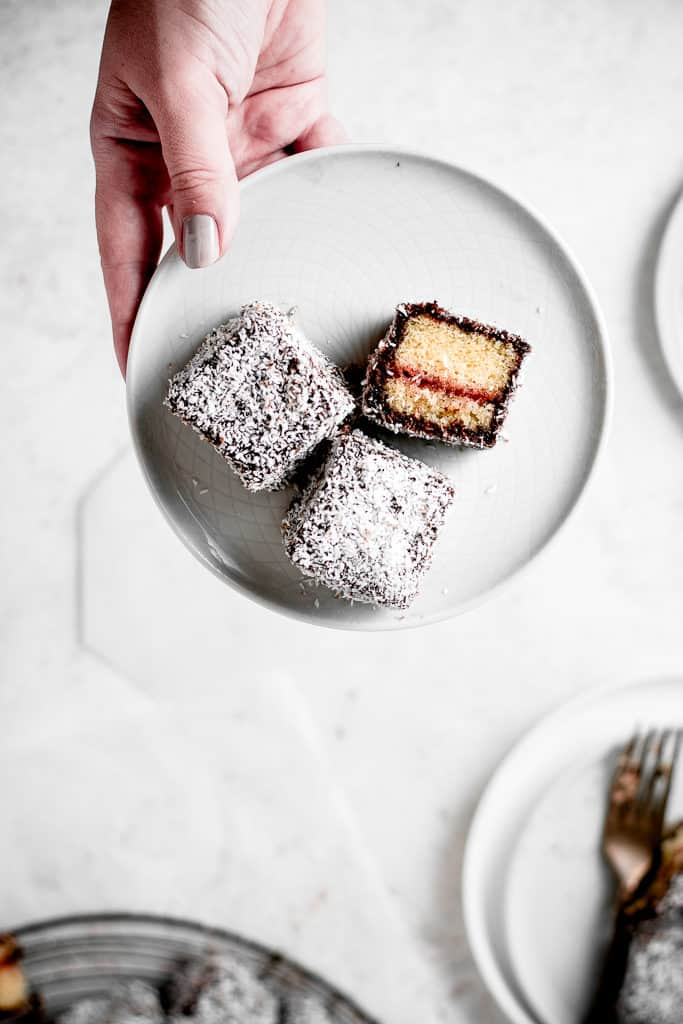 These Lamingtons are the perfect combination of soft and moist vanilla cake, strawberry jam and luscious chocolate icing with coconut coating. Perfect for the holidays or a Sunday afternoon! ⎪www.anasbakingchronicles.com
