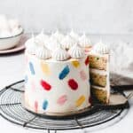 This Funfetti layer cake is perfect for birthdays, celebrations or just because! Soft and moist vanilla funfetti cake layers, paired with silky vanilla buttercream and filled with homemade strawberry jam. Learn how to make it from scratch, it's easy! www.anasbakingchronicles.com