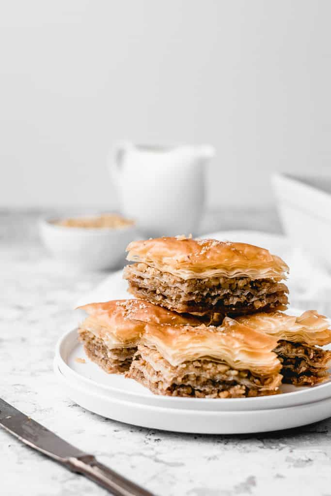 Classic Balkan walnut baklava, spiced with cinnamon and soaked with orange and lemon infused sugar syrup. Easy to make and ready for cozy fall weekends! | www,anasbakingchronicles.com