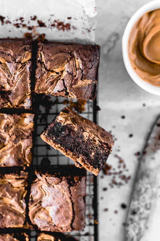 These Cookie Butter Swirl Brownies are one of the best things I've ever made. With a biscoff cookie crust on the bottom, luscious fudgy brownie in the middle and biscoff cookie butter swirl on top - this is THE chocolate dessert you need in your life!