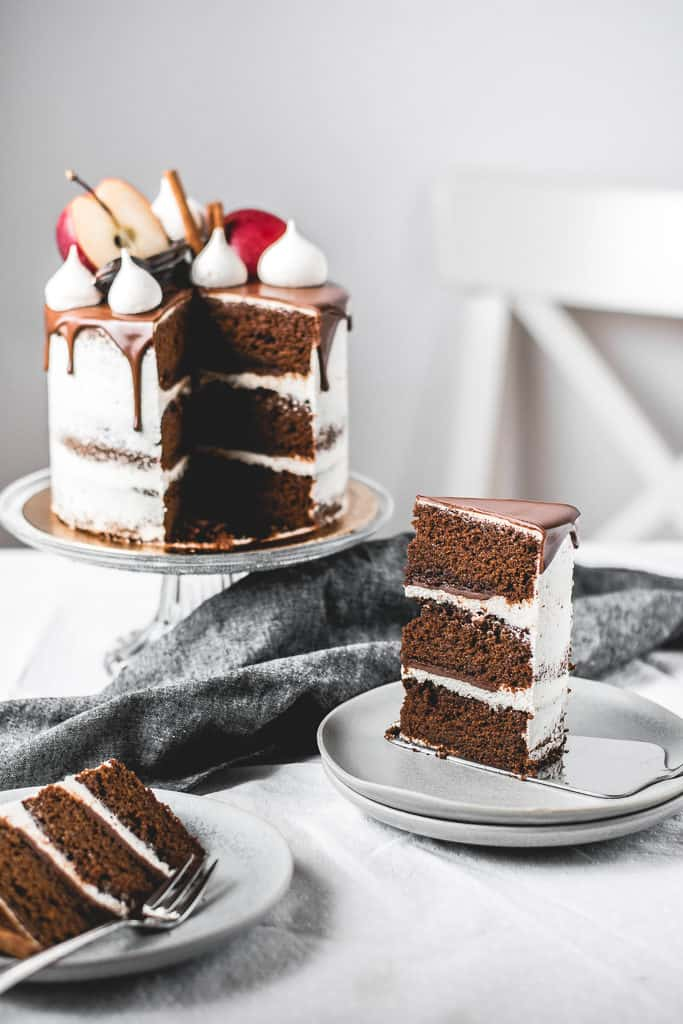Fluffy and moist carob apple cake, filled with delicious chocolate ganache and coated in light rum buttercream frosting. Perfect fall combination! | www.anasbakingchronicles.com