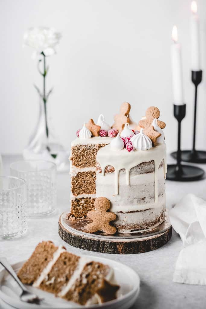 This Gingerbread Orange layer cake is just the dessert you need this winter! Three layers of soft and moist Gingerbread cake, paired with delicious and tangy Orange Cream Cheese frosting. ⎪www.anasbakingchronicles.com  #gingerbreadcake #gingerbreadlayercake #layercakes #orangecreamcheesefr