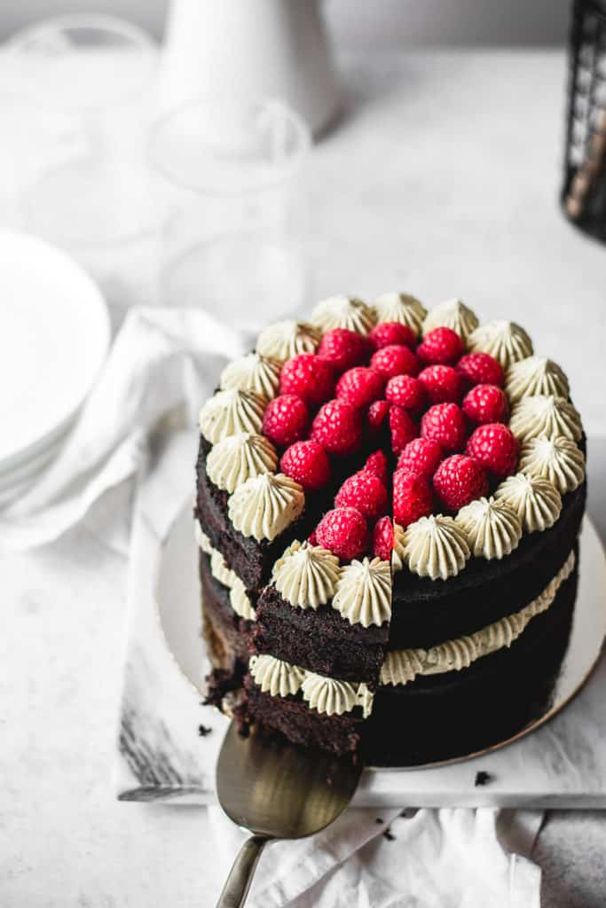 Rich and moist chocolate cake, paired with silky pistachio buttercream and homemade raspberry jam. So festive and easy to make! ⎪www.anasbakingchronicles.com