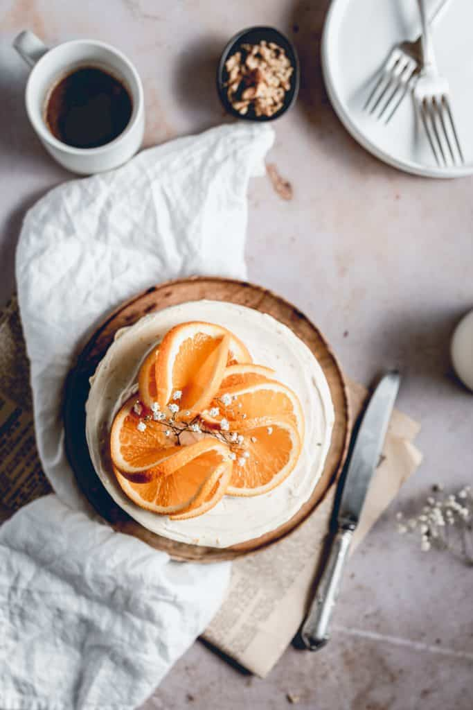This delicious Carrot Cake is the perfect choice for special occasions or just because it's Sunday! Packed full of carrots, cinnamon and walnuts, it's paired with tangy Orange Cream Cheese frosting and will quickly become your favourite!